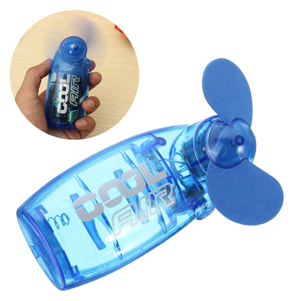 Portable Hand Fan : Mini portable pocket fan cool air hand held battery travel